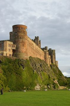 Bamburgh Castle, Northumberland. Bamburgh then became the property of the reigning English monarch. Henry II probably built the keep. As an important English outpost, the castle was the target of occasional raids from Scotland.