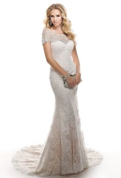 Brides: Maggie Sottero. Corded lace on tulle over Valentina satin. Optional bead embroidered tulle jacket featuring Swarovski crystals.��More details from Maggie Sottero
