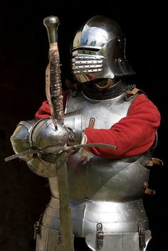A man at arms with a beautiful North Italian Bellowsface sallet, Some decent Cuirass & Gauntlets and a powerful Greatsword.