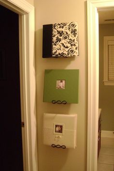 Use plates hangers to display photo albums.