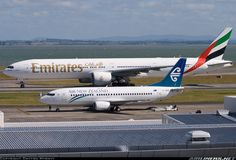 Emirates Boeing taxiing past a stationary Air New Zealand Boeing ZK-NGG at Auckland-International, January (Photo: Dmytro Myrnyy) Boeing Aircraft, Passenger Aircraft, Boeing 777, Airplane Drone, Emirates Airline, Air New Zealand, Commercial Aircraft, Civil Aviation, Aircraft Pictures
