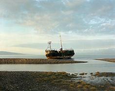 Joel Sternfeld  Abandoned Freighter, Homer, Alaska, July 1984  from American Prospects