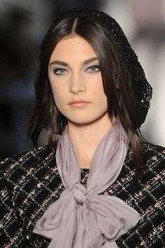 Models had stand out eyes with dark liner and smokey shadows at the Chanel fashion show.