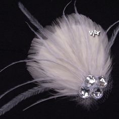 VILY Handmade Bridal Feather Fascinator Crystal Hair Clip WHITE. $12.60, via Etsy.