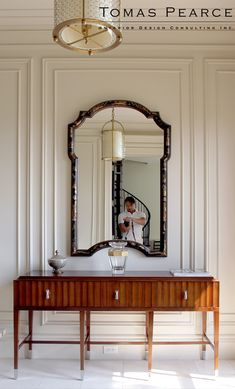CLASSIC ENTRYWAY  nothing like a huge mirror and a classic console table design to set the elegance in a entry hall   www.bocadolobo.com #modernentryway #entrywayideas