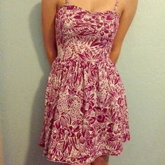 Floral Dress very pretty spring/summer floral dress, adjustable straps and removable. it has pockets(: magenta color...very fitting on the waist. like new! wore it for graduation in 2013 Aeropostale Dresses