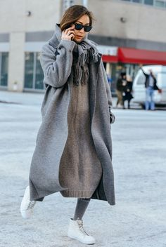 Oversized coats are the best way to keep warm.