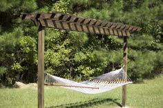 Escaping to a backyard hammock is a special treat. But without sturdy, hang-worthy trees, your options are fairly limited. If you're the DIY type, you may be interested in this guide to building a simple pergola that can safely support your hammock. Diy Pergola, Building A Pergola, Pergola Swing, Deck With Pergola, Outdoor Pergola, Cheap Pergola, Wooden Pergola, Covered Pergola, Backyard Pergola
