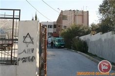 Settlers spray-paint racist graffiti on Nablus school