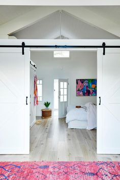 A colourful coastal cottage in Byron Bay | real living Modern Coastal, Modern Country, Modern Family, Modern Decor, Home And Family, Coastal Style, Ikea Storage Boxes, Making Barn Doors, Custom Shelving