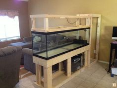 aquarium - just need to frame it out with some bead board - bottom cabinet doors - light on top - maybe planters.divider aquarium - just need to frame it out with some bead board - bottom cabinet doors - light on top - maybe planters. Decor, House Design, House, Interior, Home, Fishing Room, New Homes, Fish Tank Stand, Room Divider