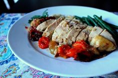 Lemon Garlic Roast Chicken with Tomatoes on Mary Ellen's Cooking Creations. Bone in chicken breasts seasoned with lemon, garlic, thyme, and balsamic then roasted with tomatoes and garlic.
