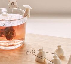 These Chinese Fisherman Sit On Your Cup And Hold Your Tea Bag Like A Fish