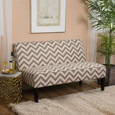 Felmas Dark Gray Pine Loveseat As some spice and flavor to your life and living room with the Felmas Pine Loveseat. Available in select colors, this love seat is sure to draw the crowd and add that little something extra to your living room. The zig zag pattern featured on this http://www.shareasale.com/m-pr.cfm?merchantID=69984&userID=1079412&productID=689115925