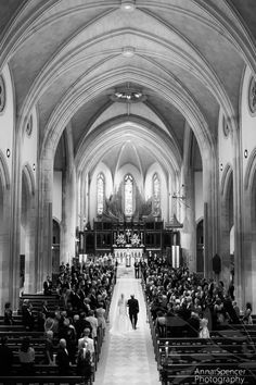 bride and her father walking down the aisle during a wedding ceremony at the cathedral of