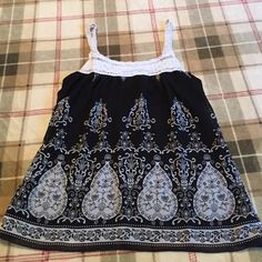 Shear Top Cute summer top with knitted straps with a black and white pattern. It has a black under silk shirt made to it HeartSoul Tops