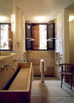 Au natural bathroom...love the stone, the double shower heads and sink basin.