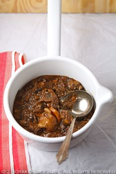 Traditional South African Oxtail and Red Wine Potjiekos (Slow-Cooked Stew Done In A Cast-Iron Pot Over Coals)