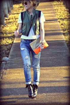 Edgy   utility vest, white tshirt, distressed denim, lace-up booties