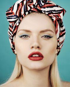 Red lips, blue liner. (Martina Dimitrova by Vasil Germanov for 12 Mag)