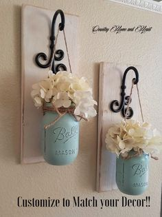These rustic country style mason jar sconces are the perfect touch to your home decor. They bring warmth and beauty to any room. This listing is for 2 Sconces so for each quantity of one at checkout you are ordering one set of 2.  {{{{{JARS ARE PAINTED IN SEAFOAM BLUE}}}}  Scroll through the listing to see your sconce finish/flower/jar paint color options. The Sconce pictured is done in Antique White the Jars are done in Sea-foam Blue. (Flowers are optional)  {PLEASE LEAVE ME A NOTE...