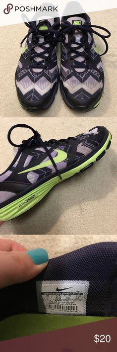 Nike Dual Fusion Sz 7 Purple print, lightly used Lightly used Purple print Nike Dual Fusion TR sneakers.  Small worn patches on the inner heals as shown in the last picture.  Worn patches is only through the lining.  Women's size 7. *Don't forget to bundle and save!* 😀 Nike Shoes Athletic Shoes