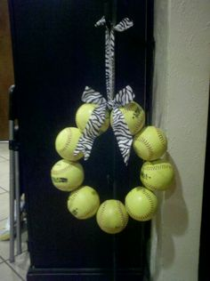 Softball Wreath w/zebra bow.  Cute coaches gift with each girl's signature on a ball.