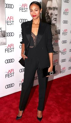 Zoe Saldana in a lace top and black suit