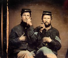 """Guys gone wild, 1860s style. """"Unidentified soldiers in Union uniforms holding cigars in each other's mouths."""" Ninth-plate tintype, hand-colored. Liljenquist Family Collection of Civil War Photographs, Library of Congress.    http://www.shorpy.com/node/15309?size=_original"""