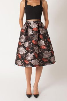 The Josephina skirt is from the Janie Bryant for Black Halo collection and features double box pleating and side slit pockets for added flare and is constructed from a floral jacquard from France. Pair with black sweater crop top etc.  Josephina Floral Skirt by Black Halo. Clothing - Skirts - A Line Clothing - Skirts - Midi Back Bay Boston Massachusetts