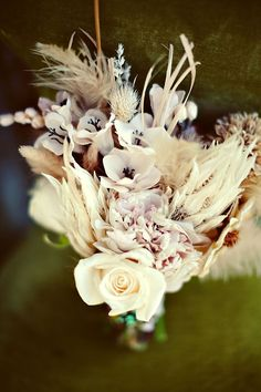 textured cream bouquet of anemones, wheat, roses, peonies and poinsettias
