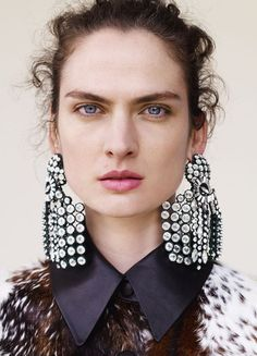 Rhinestone earrings appeared on the runway at Celine, Balenciaga and Saint Laurent. Here's how to pull them off.