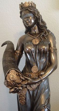 Tyche is the Greek goddess of luck, fortune, and chance. Her Roman equivalence is Fortuna, and a key sign she is influencing your life is if you tend to find lots of spare change in odd places. Tyche is usually portrayed with a cornucopia, a rudder of destiny, and a wheel of fortune.