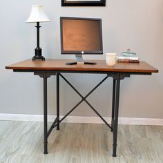 Classic craftsman-style table can be used as a small dining table or a home office desk – its metal legs and open design make it a perfect small apartment table.