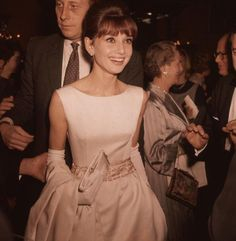 1961: Audrey Hepburn wearing a white satin evening gown and long gloves.  Photo: Fox Photos/Getty Images   Read more: http://stylecaster.com/audrey-hepburn-style/#ixzz3Ph5gcddW