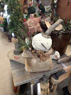 Primitive Snowman and a Star in a Bag                                                                                                                                                                                 More