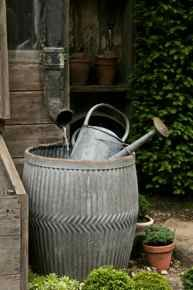 rain barrel and watering can, galvanized.