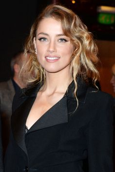 Amber Heard   The actress offset the formality and clean lines of her tux and winged eyeliner with a hairstyle that walked the line between slept-in and polished. Make a deep side part and run a curling wand through the front sections, then loosen up the waves with your fingers. Pull hair back into a loose ponytail, encouraging any pieces that fall out along the way, then tuck it under against the nape and secure with bobby pins. How To Captivate A Man http://how-to-captivate-a-mantoda...