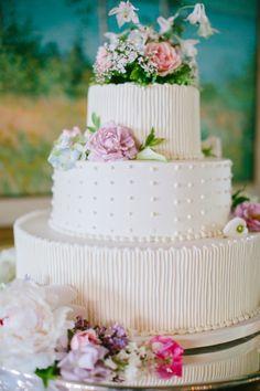 White textured wedding cake: http://www.stylemepretty.com/maine-weddings/2015/01/21/elegant-seaside-garden-wedding/ | Photography: emily Delamater - http://emilydelamater.com/