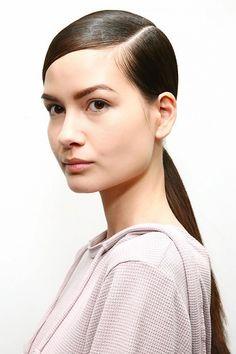 Sleek part + low ponytail