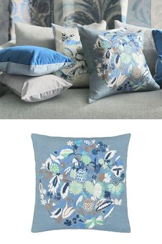 Giradon Ocean Cushion - A luxurious square cushion with a dense circular set pattern of flowers and foliage in dazzling blue and azure tones with highlights of white