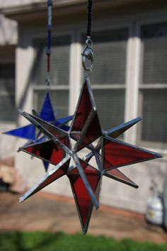 Guest Artist Feature - DALE HENNING  We are featuring Dale's  dimensional stained glass stars and mobiles this spring at Peace on My Porch.  What is interesting is that Dale did not get started making his artwork until age 80. His love of color and repetition is evident in each hand-made piece he creates.
