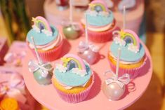 The cupcakes at this beautiful unicorn and rainbow birthday party are so cute! See more parties and share yours at CatchMyParty.com #catchmyparty #partyideas #rainbowparty #rainbowcupcakes #unicornparty #girlbirthdayparty