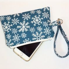 Likes, 1 Comments - Jennifer & Mandy (@jenniferandmandy) on Instagram: How about a snowflake wristlet?? This one is sold, but there will be more... #snowflakes #giftideas #etsy #handmade #wristlet #zipperpouch #giftforher #madeinnashville #jenniferandmandy