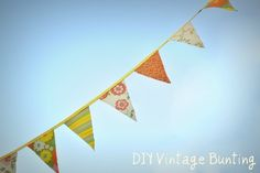 Step by step tutorial on making a nice bunting from vintage sheets (or other fabric).  I'm thinking of using some 4th July stuff that was on clearance last year at JoAnns...