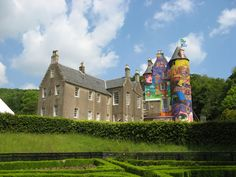 This is the Kelburn Castle in Scotland, painted over by Brazillian street artists from Sao Paulo Nina and Nunca, Os Gemeos (The twins), completed in June 2007.
