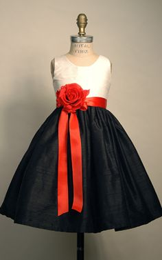 flower girl dresses. Just change the black to aqua or all aqua with the red flower