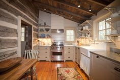 Kitchen. Pale gray cabinets with drawers, open shelves, farm sink