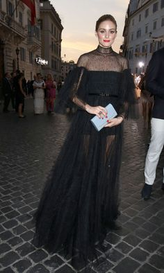 Olivia Palermo arriving at the Valentino show in Rome. See more of the fashion It girl's best looks.