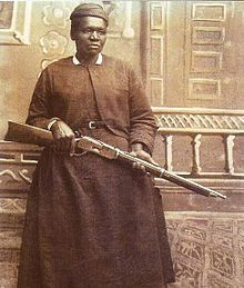 Mary Fields, nickname Stagecoach Mary, was a former slave who became the first African-American woman to work for the US postal service when, about age 60, she was the fastest applicant to hitch up a team of 6 horses in the Montana Territory. She wore a pistol under her apron and when the snow was too deep for the horses she would carry the mail on her back and deliver it on snowshoes. She never missed a day. When the town of Cascade banned women from saloons, the mayor granted her an exemption.
